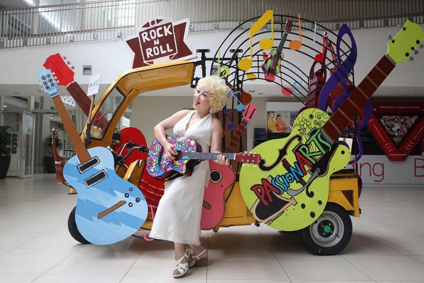 Ms Susan Teo, a volunteer leader with the PAssionArts Guitar Contingent, with her vehicle.