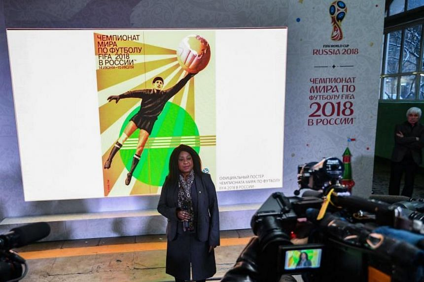 Fifa secretary-general Fatma Samoura unveils the official poster for next year's World Cup Finals in Moscow on Nov 28, 2017.