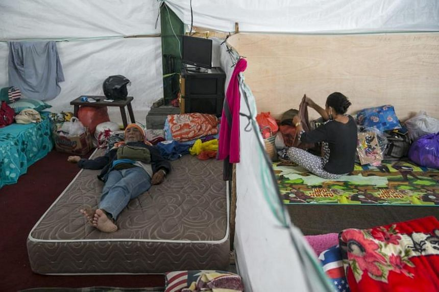 Evacuees stay in a temporary shelter on Nov 28, 2017, after Mount Agung spewed hot volcanic ash in Karangasem, Bali, Indonesia.