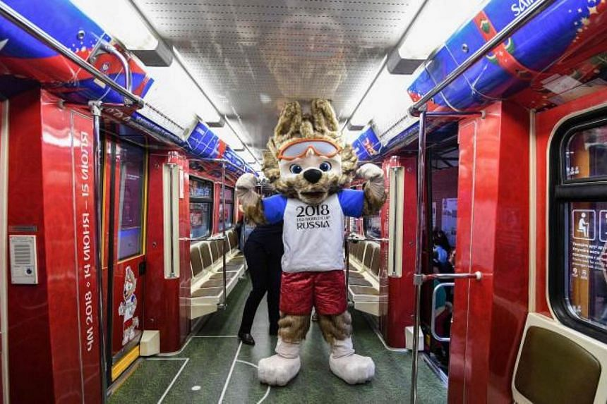 Zabivaka, the official mascot for the 2018 FIFA World Cup Russia, attends the unveiling of the official poster for the 2018 FIFA World Cup at Moscow's Krasnaya Presnya metro depot on Nov 28, 2017.