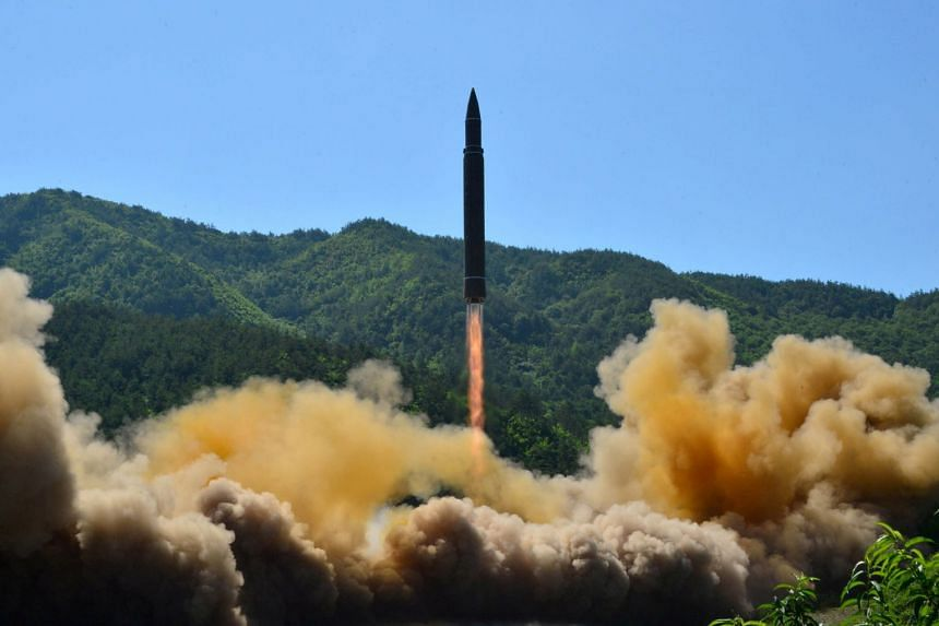 The intercontinental ballistic missile Hwasong-14 is seen during its test in this undated photo.