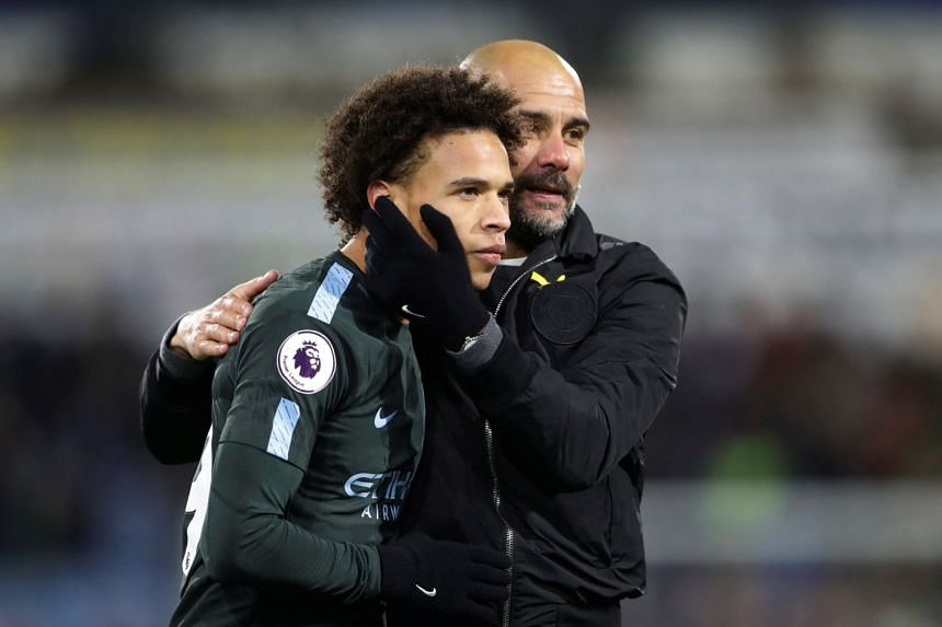 Pep Guardiola and Leroy Sane celebrate after the match against Huddersfield Town.