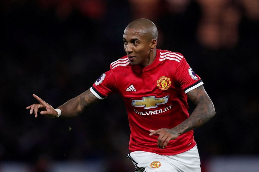 Manchester United's Ashley Young celebrates scoring their second goal.
