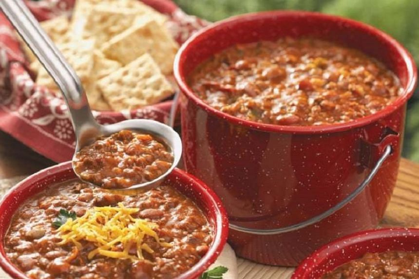 Chilli is a hot and spicy stew consisting primarily of beans, tomatoes and ground beef.