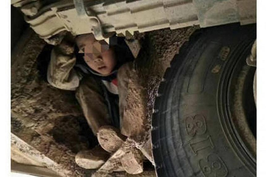 The boys from a rural village in Guangxi, who were reported missing by their teacher, were found clinging to the undercarriage of a bus. They were covered in mud but were unharmed although the bus had travelled across steep terrain for 5km of the 80k