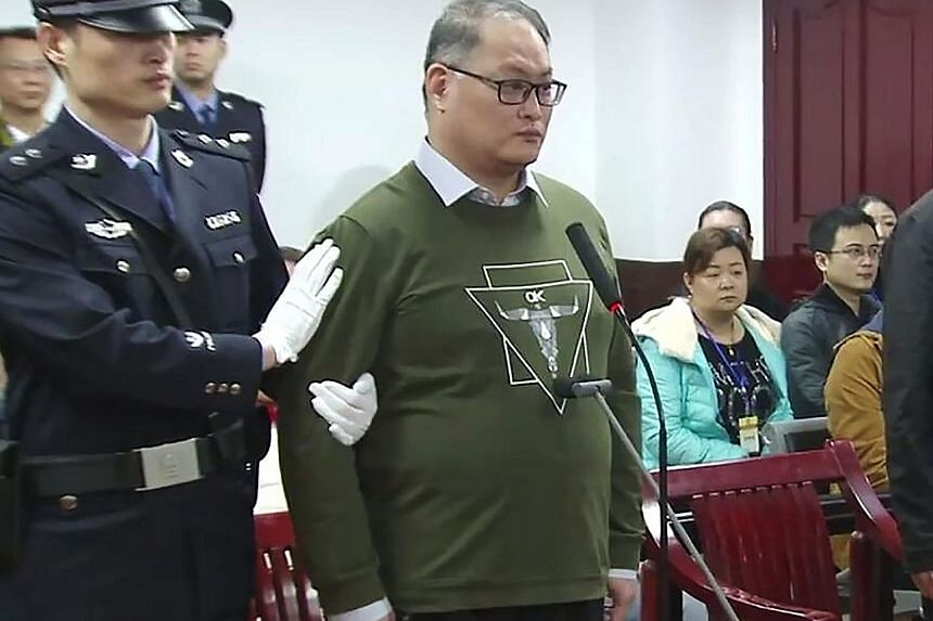 Activist Lee Ming-cheh in court yesterday. He is the first Taiwanese person to be convicted in China on the political charge.