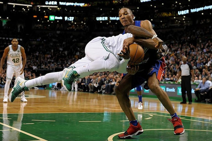 Detroit's Avery Bradley pulls out all the stops to prevent Boston's Kyrie Irving from getting the better of him, as he grabs a hold of the Celtics guard during the Pistons' 118-108 win.