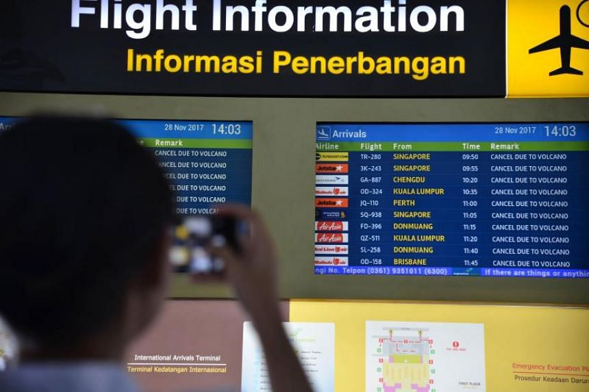 A flight information board shows the list of cancelled flights due to Mount Agung at the  I Gusti Ngurah Rai International airport in Denpasar, Bali on November 28, 2017.