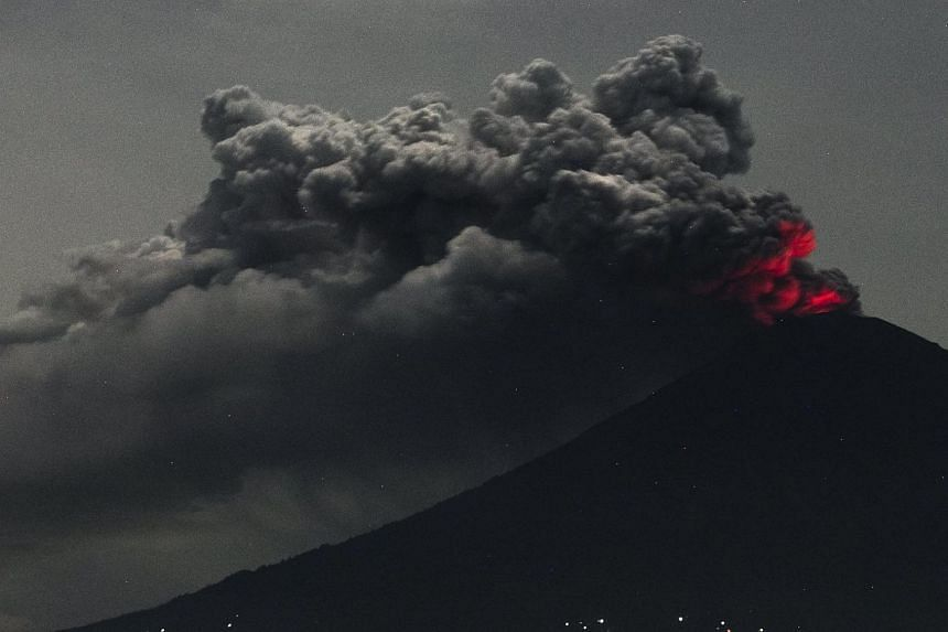A long exposure photograph shows the Mount Agung volcano spewing hot volcanic ash seen from Amed in Bali, Indonesia on Nov 28, 2017.