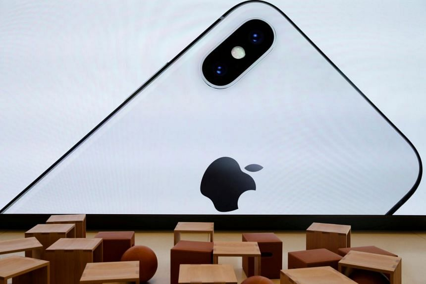 An iPhone X is seen on a large video screen in the new Apple Visitor Center in Cupertino.