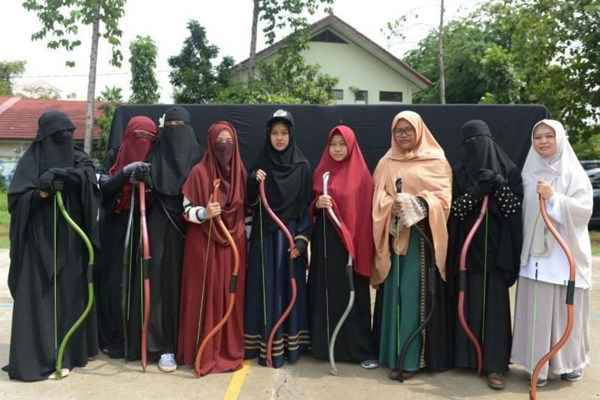 The Niqab Squad meets to recite the Quran or, at one recent gathering, tried their gloved hands at archery, one of the activities endorsed by the Prophet Mohammed.
