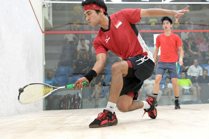National squash player Samuel Kang (left, with red headband)  at the Old Chang Kee-Marigold Singapore Open at Kallang SquashCentre on Dec 1, 2016.