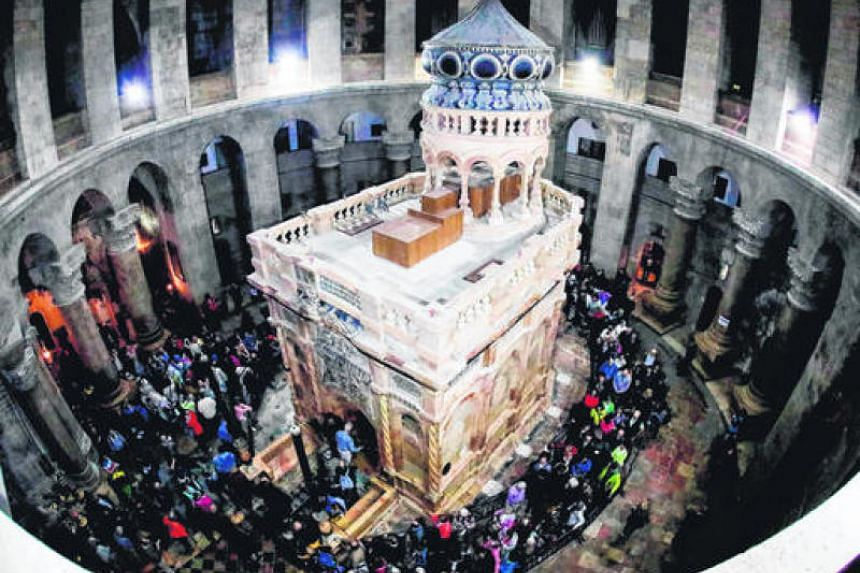A picture taken at the Church of the Holy Sepulchre in the Old City of Jerusalem shows the Edicule of the Tomb of Jesus, where his body is believed to have been laid.