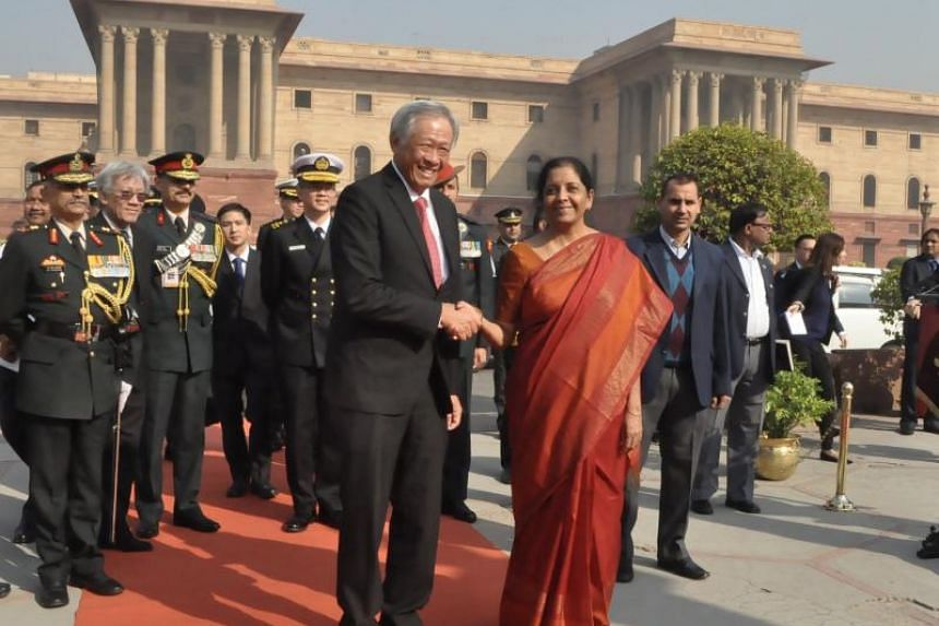 Defence Minister Ng Eng Hen is met by his Indian counterpart Nirmala Sitharaman upon his arrival at India's Ministry of Defence.
