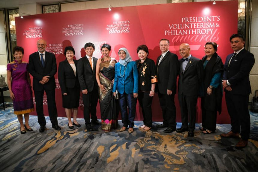 President Halimah Yacob poses for a photo with the winners and representatives of the winning organisations and companies of the President's Volunteerism and Philanthropy Awards 2017, on Nov 29, 2017.