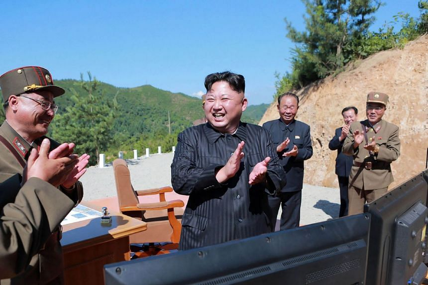 North Korean leader Kim Jong-Un (centre) celebrating the successful test-fire of the intercontinental ballistic missile Hwasong-14 earlier in 2017.