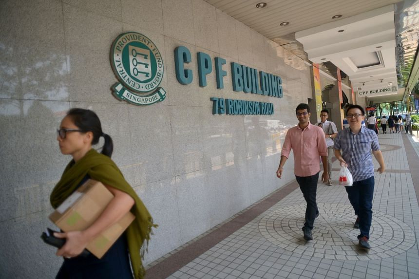 People walking past the CPF building on Robinson Road.