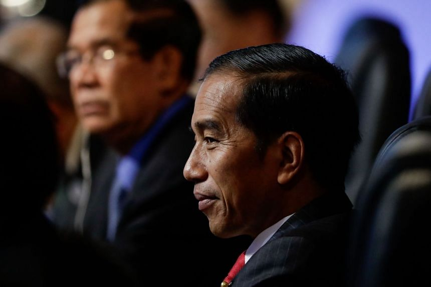 Indonesian President Joko Widodo looks on during the Asean Canada 40th Anniversary Commemorative Summit on the sideline of the 31st Association of Southeast Asian Nations (ASEAN) Summit in Manila on Nov 14, 2017.