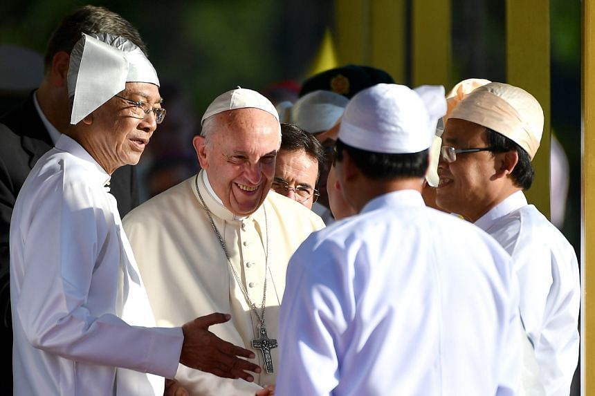 Pope Francis being welcomed yesterday by Myanmar President Htin Kyaw (left) during a ceremony at the Presidential Palace in Naypyitaw. Powerful military commander-in-chief Min Aung Hlaing met the Pope on Monday.