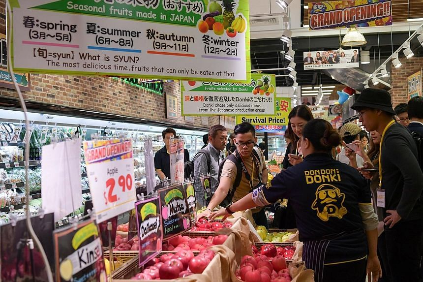 Don Don Donki's product selection of about 30,000 items includes fresh vegetables and meats.