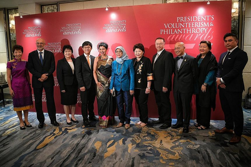 President Halimah Yacob (centre) is flanked by (from left) Minister for Culture, Community and Youth Grace Fu; DBS Group CEO Piyush Gupta; Hougang Secondary School vice-principal Yoong Jin Ing; Kodrah Kristang founder and director Kevin Martens Wong;