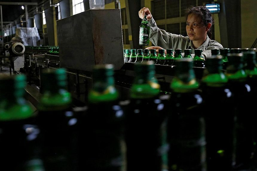 A worker checking beer bottles at a Sabeco factory in Vietnam. Shares of Sabeco have more than doubled since its listing last December on expectations of the stake sale.