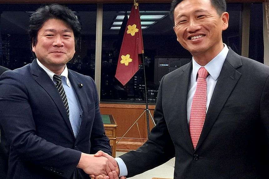 Minister for Education (Higher Education and Skills) Ong Ye Kung (at right) with Japanese State Minister of Defence Tomohiro Yamamoto at Japan's Ministry of Defence yesterday.