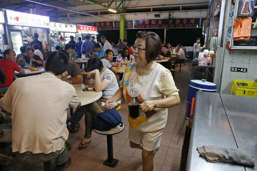 Madam Wee Cheu Boi, a drinks stall assistant at the Old Woodlands Town Centre hawker centre.