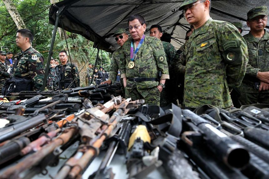 Philippine President Rodrigo Duterte examining seized weaponry from Islamist militants during a visit to a military camp in Marawi on the southern island of Mindanao.