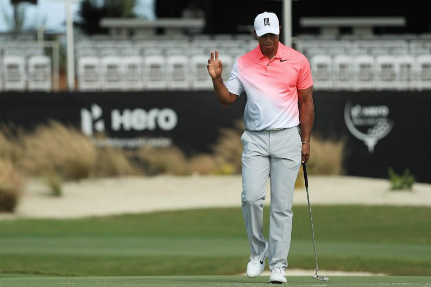 Woods waves during the pro-am prior to the Hero World Challenge, Nov 29, 2017.
