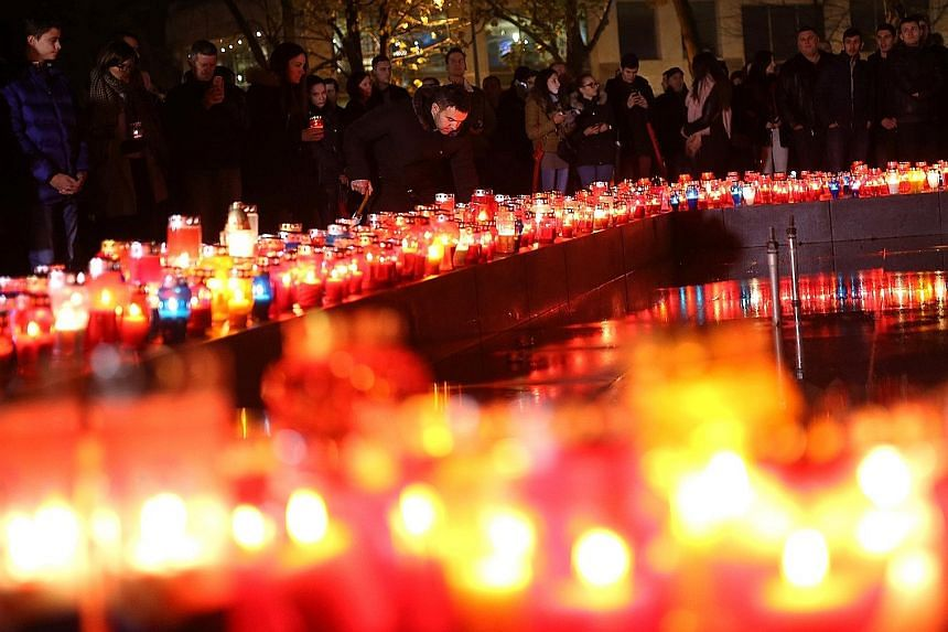 Croats lighting candles on Wednesday for war criminal Slobodan Praljak, who killed himself seconds after the UN war crimes tribunal at The Hague upheld his 20-year sentence.