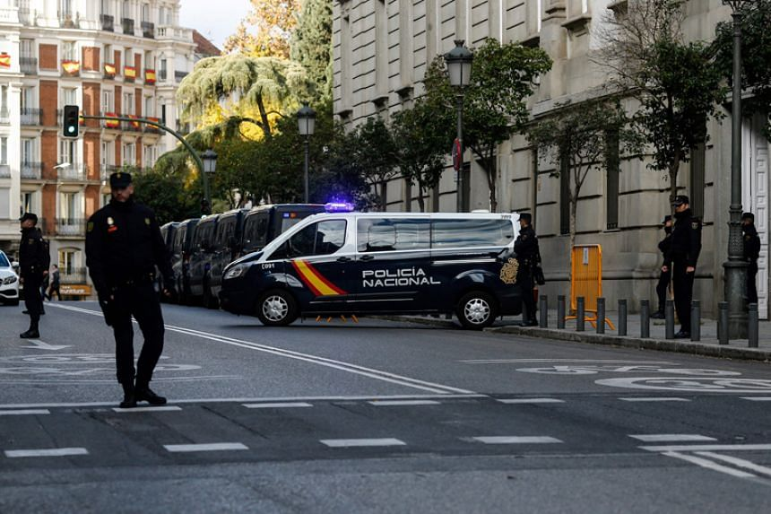 A police van carrying Catalan separatist leaders arrives at the Supreme Court in Madrid on Dec 1, 2017.