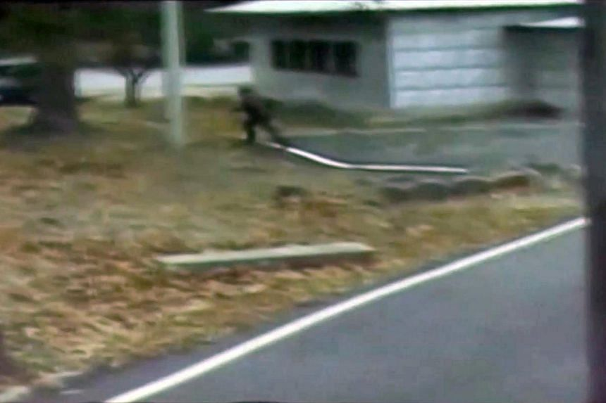 CCTV footage shows a North Korean soldier crossing the white Military Demarcation Line.