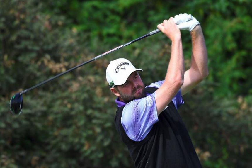 Marc Leishman (above) at the CJ Cup at Nine Bridges in Jeju Island in October. He and Adam Bland carved out a two-stroke lead at the top of the leaderboard after the second round of the Australian PGA Championship in Gold Coast.