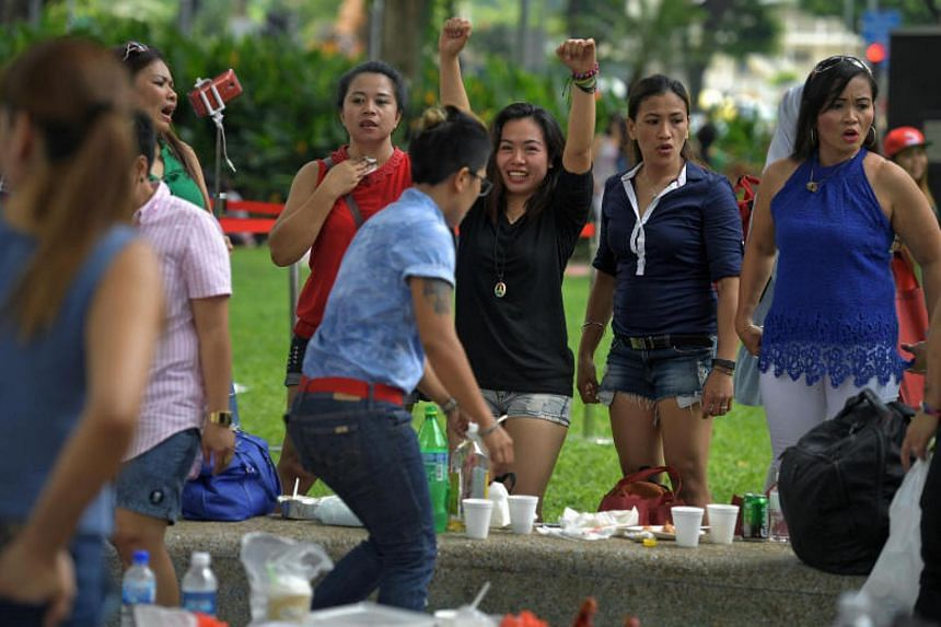 Foreign domestic workers enjoying the carnival-like atmosphere at the May Day Domestic Employees Celebration at the Youth Park@ Somerset on May 7, 2017.