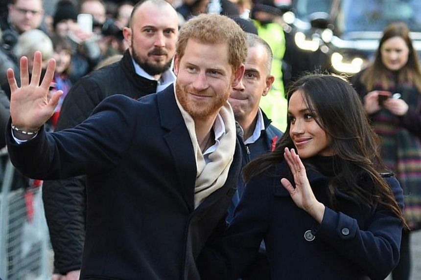 Britain's Prince Harry and his fiancee US actress Meghan Markle on their first official engagement together at Nottingham Contemporary on Dec 1, 2017.