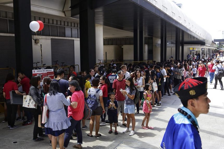 Hundreds queue to get their drinks from the new Gong Cha outlet at SingPost Centre on Dec 1.