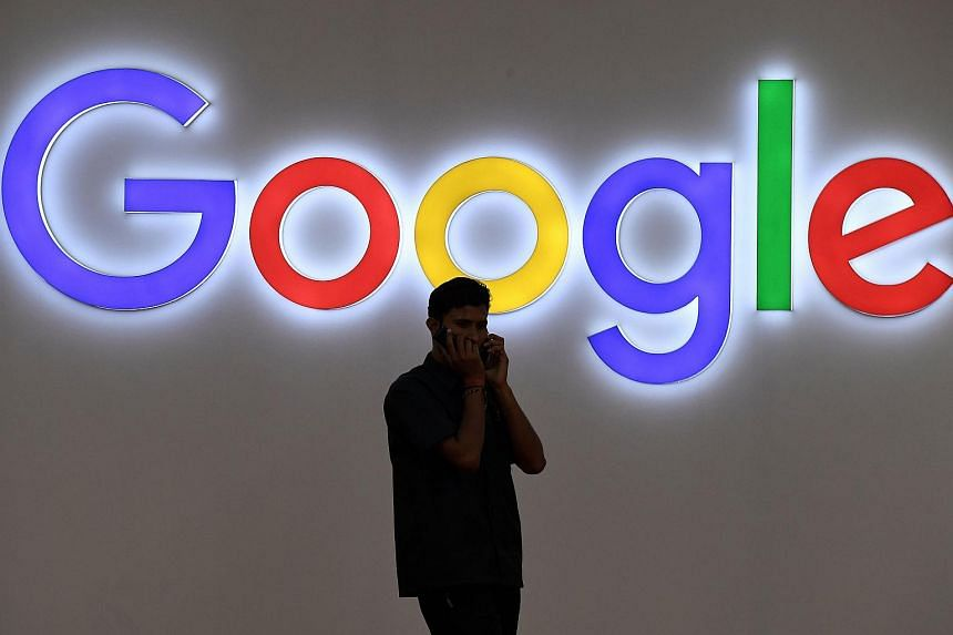 An Indian visitor outside the Google stall at the India Mobile Congress in New Delhi on Sept 27, 2017.