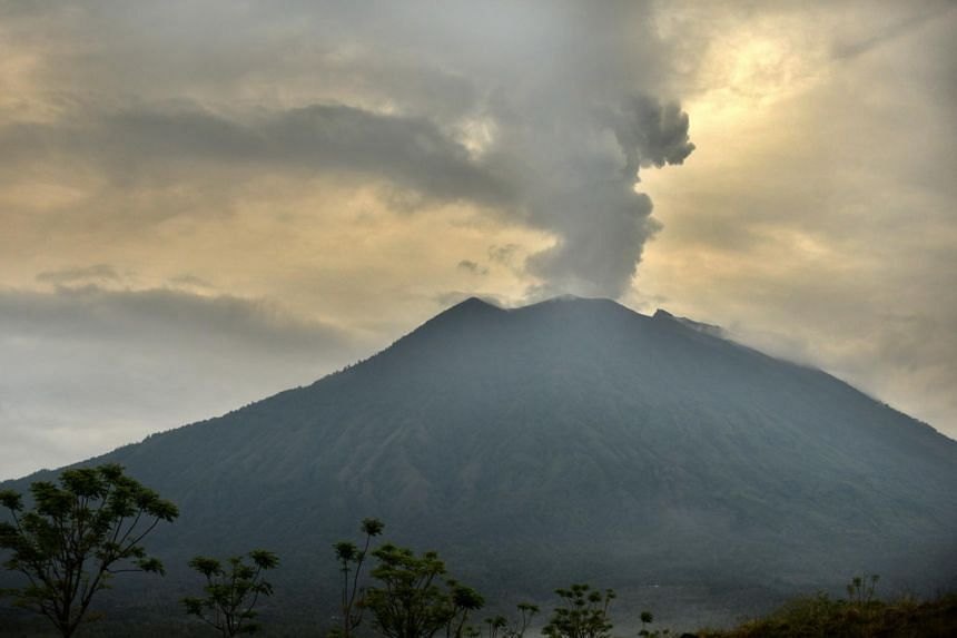 The erupting Mount Agung volcano in Bali. Ash and smoke ejected so far by the volcano has not been big enough or high enough in the atmosphere to cool world temperatures.