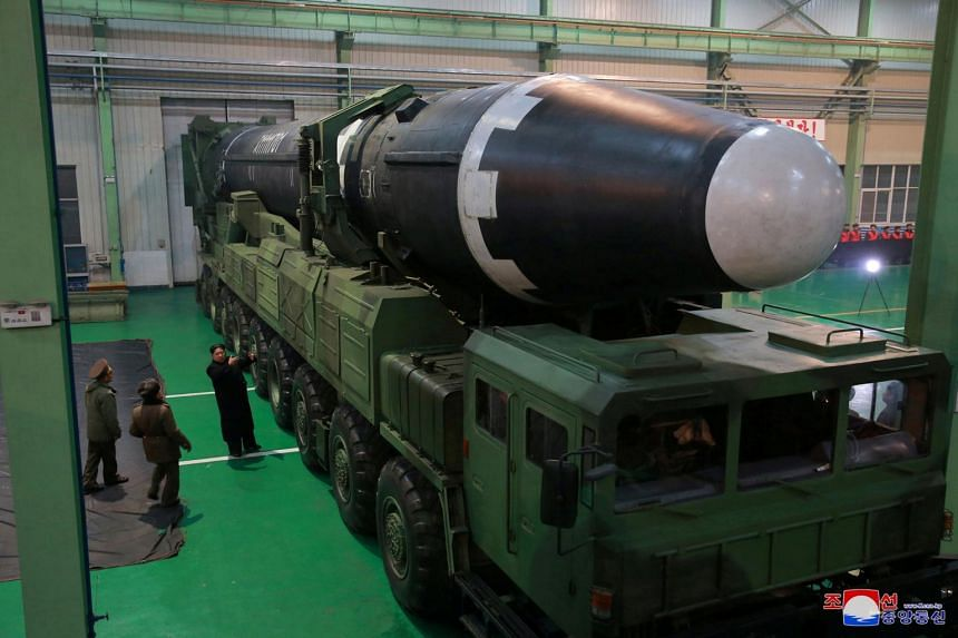 North Korea's leader Kim Jong Un with the newly developed intercontinental ballistic rocket Hwasong-15.