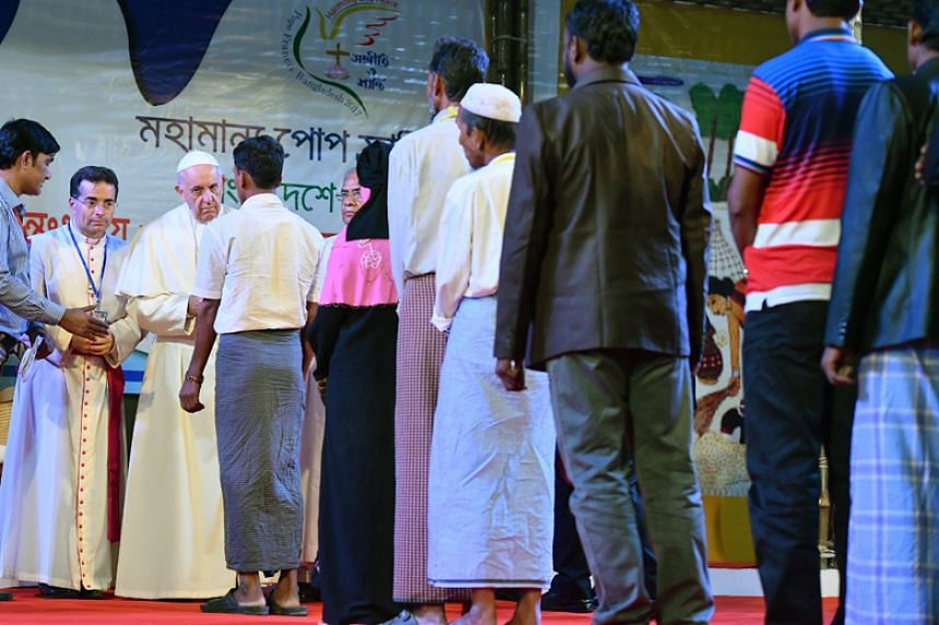 Pope Francis meets with Rohingya refugees during an Interreligious and Ecumenical meeting for peace at the garden of the Archbishop in Dhaka on Dec 1, 2017.