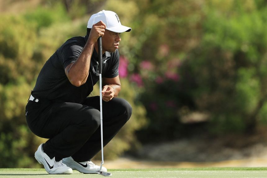Woods lines up a putt on the seventh green during the first round of the Hero World Challenge.