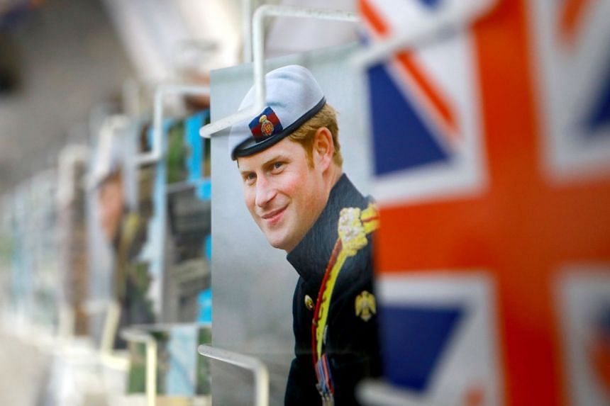 Royal postcards with Britain's Prince Harry on display for sale in a store in Windsor on Nov 29.