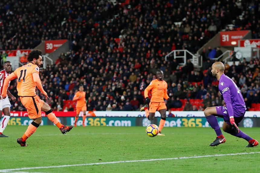 Liverpool's Mohamed Salah scoring his second goal during his side's 3-0 victory against Stoke City on Wednesday. Jurgen Klopp says the Reds have sufficient depth to get through their games in the lead-up to Christmas.