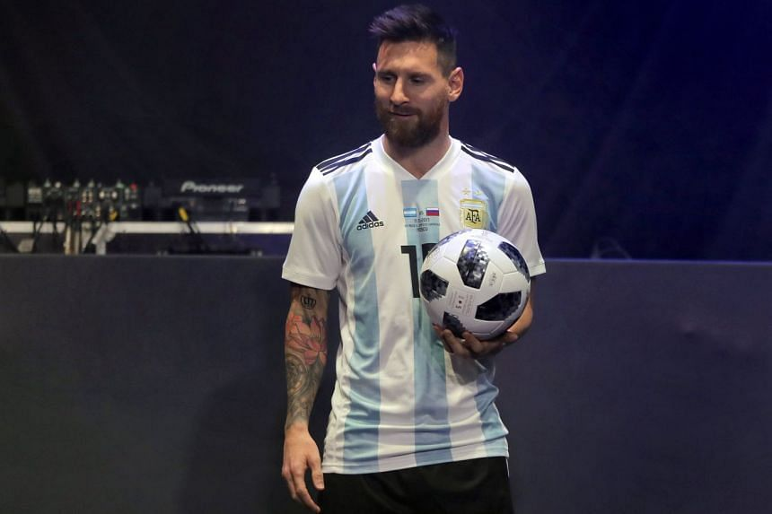 Argentinian superstar Lionel Messi with the official match ball for the 2018 World Cup, named Telstar 18, during the unveiling ceremony in Moscow on Nov 9, 2017. The two-time champions are in a tricky group with Croatia, Iceland and Nigeria.