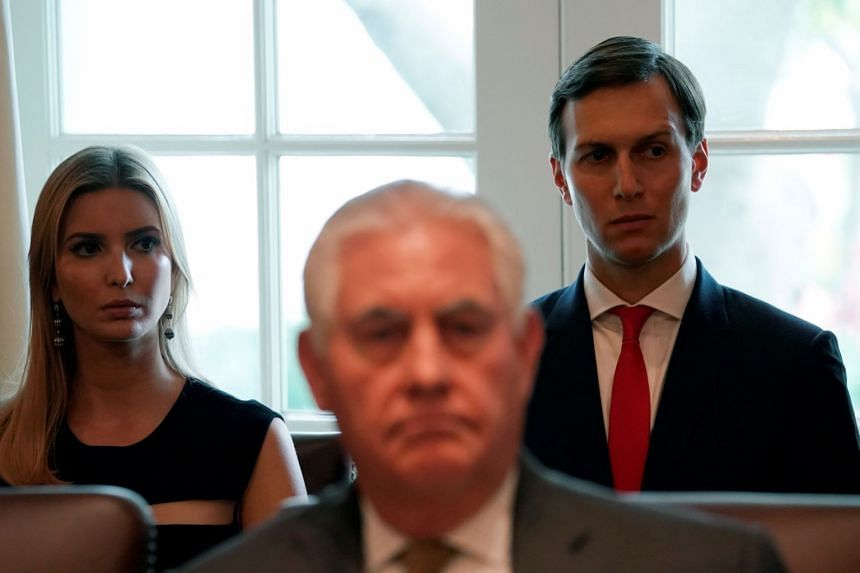 Ivanka Trump and Jared Kushner sit behind Secretary of State Rex Tillerson during a Cabinet meeting at the White House.