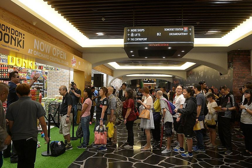 Don Don Donki at Orchard Central, which is Don Quijote's first outlet in Singapore, opened its doors yesterday at 10am. Shoppers arrived up to two hours earlier but were permitted to start queueing only at 9.15am.