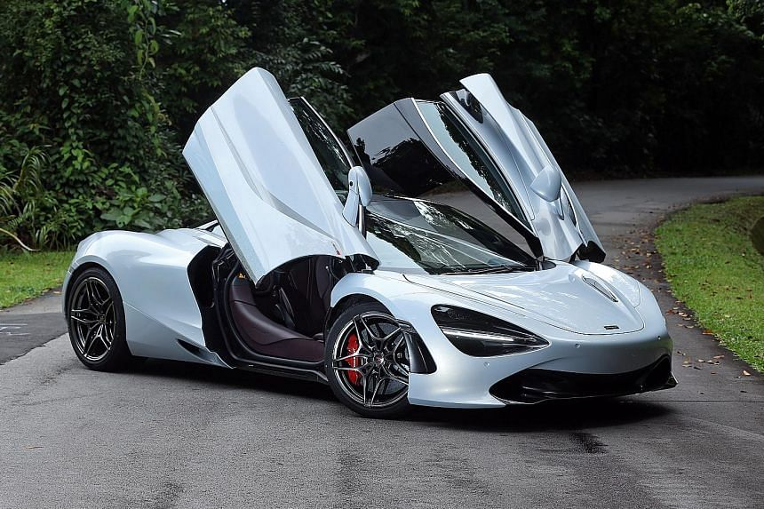 The McLaren 720S' flowing lines and leather-bound interior are a joy to behold. In Track mode, the car's rear spoiler rises.