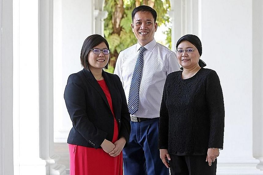 From far left: Promising Social Worker Award recipient Kristine Lam with Outstanding Social Worker Award recipients Vincent Ng and Zahara Mahmood. Ms Lam says seeing difficult cases does not make her sad or disillusioned but rather, drives her to wan