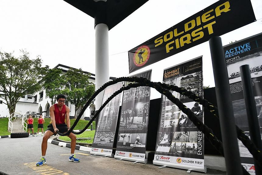Third Sergeant Rashid Mustaffa, 22, training with battle ropes at the Centre of Excellence for Soldier Performance in Selarang Camp during a media preview on Tuesday.